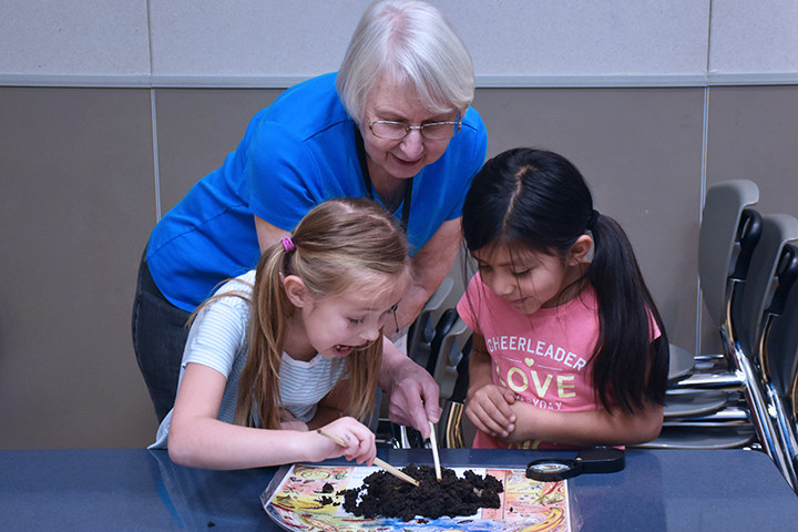 Photo of students working with Master Gardener at Hazel Dell Elementary